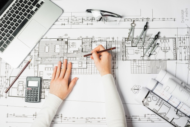 hands-drawing-architect
